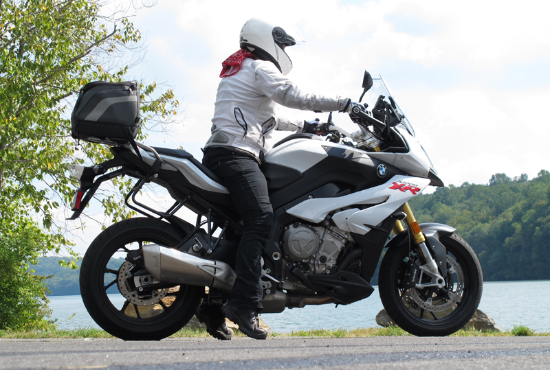 Whether riding a tall sport touring motorcycle like this BMW S 1000 XR (seat height 33.1 inches, same bike I'm on in the above photo), or a cruiser, the same techniques I've outlined below apply. This is my friend Laura, who stands 5 feet 4 inches.
