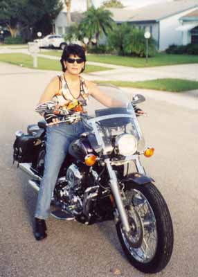 Gina accessorized her V Star with a windshield, saddlebags and other parts to make the bike comfortable for riding long distances.