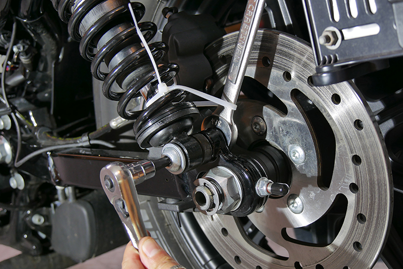 Top 10 DIY Garage Tips for Women Who Work on Their Own Motorcycles Zip Tied Wrench