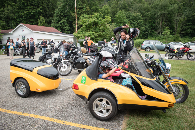 large scale womens motorcycle ride wraps up in san francisco honda shadow sidecar trailer kids