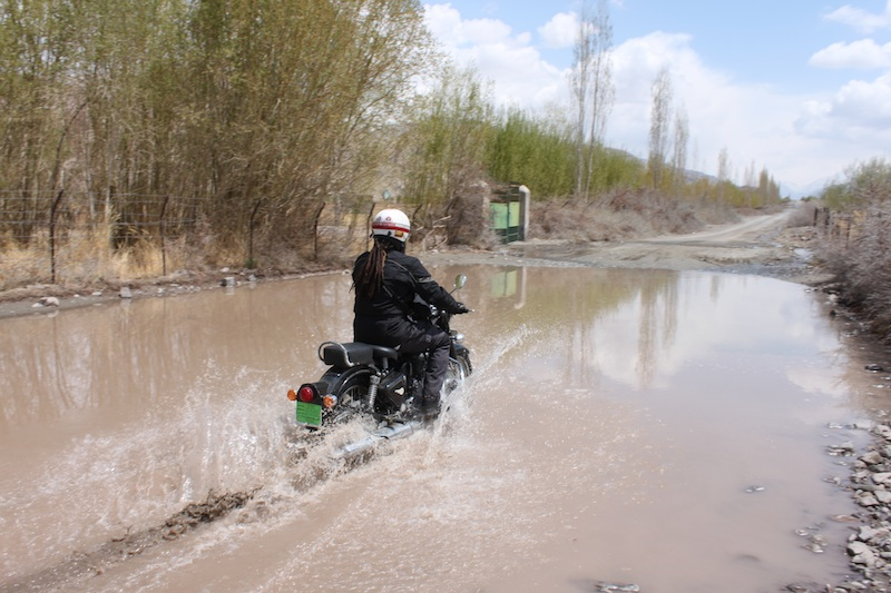 Backroads with Betsy Motorcycling in the Himalayas riding through puddle
