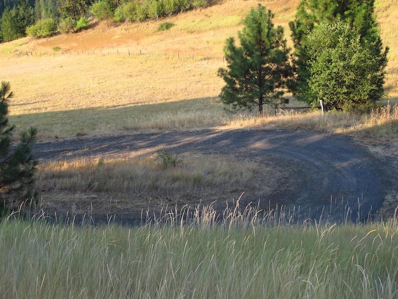 Safe Riding Motorcycle Mishap sharp turn gravel road