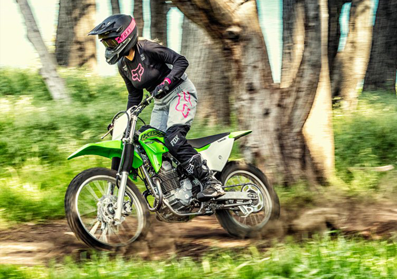 women riders basic guide to gearing up to ride a motorcycle in dirt kawasaki klx230r woman