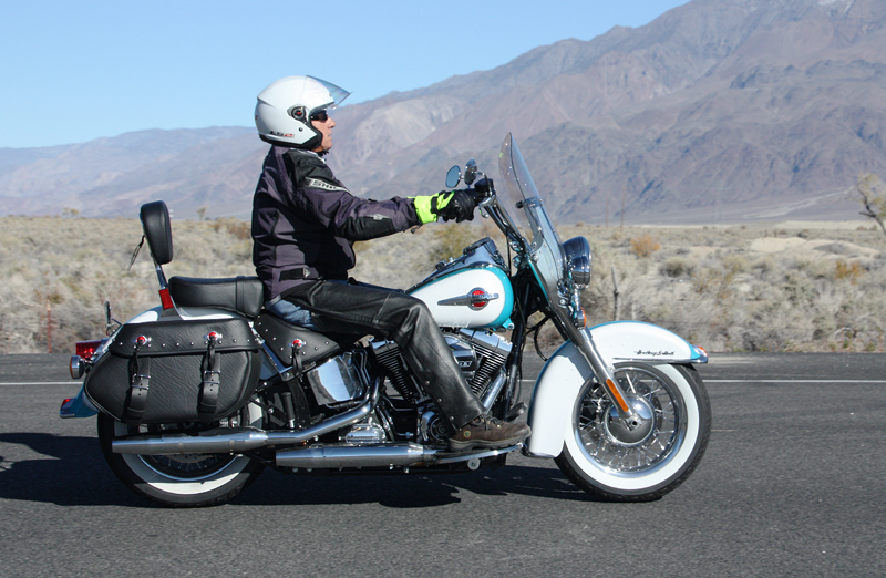 review 2016 harley davidson heritage softail classic man riding in leathers