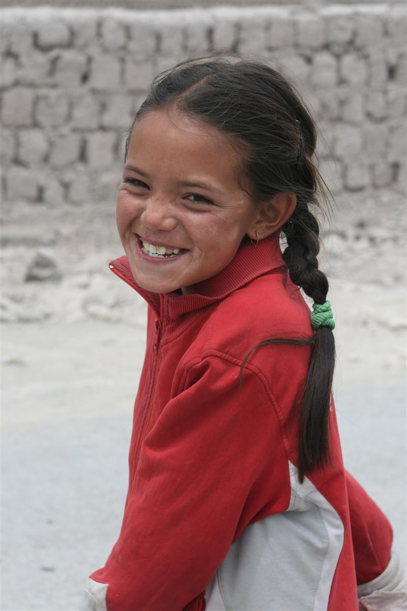 Backroads with Betsy Motorcycling in the Himalayas little girl smiling