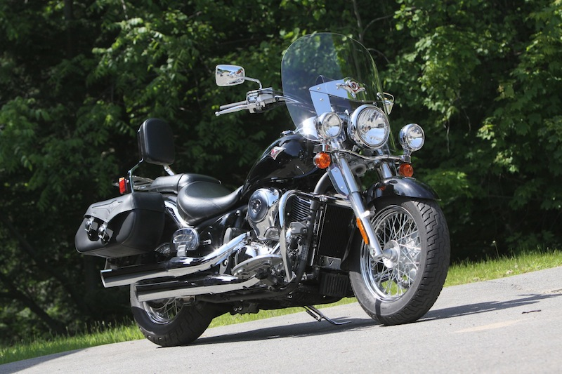 """This Kawasaki Vulcan 900 Classic is outfitted with touring accessories—a windshield, saddlebags and a backrest. The stock model does not come with these add-ons, but the Classic LT model does, so it's good to check if the manufacturer offers an """"accessorized"""" version of a bike you like. It's often cheaper to buy the model that's accessorized from the factory than to purchase those same items individually as aftermarket parts."""