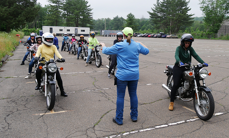 During the range portion of the class, students head out to the parking lot to learn and practice riding skills on provided small displacement motorcycles.