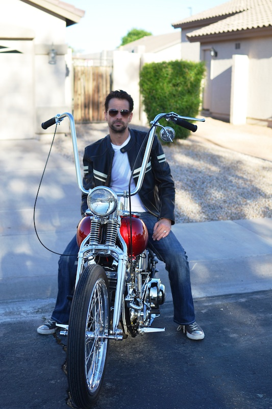 Clothing Review River Road Men's Hoodlum Jacket seated motorcycle