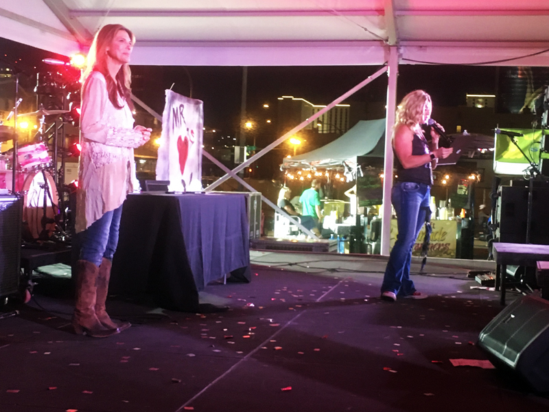 two-time motorcycle hall of famer genevieve schmitt on stage in las vegas