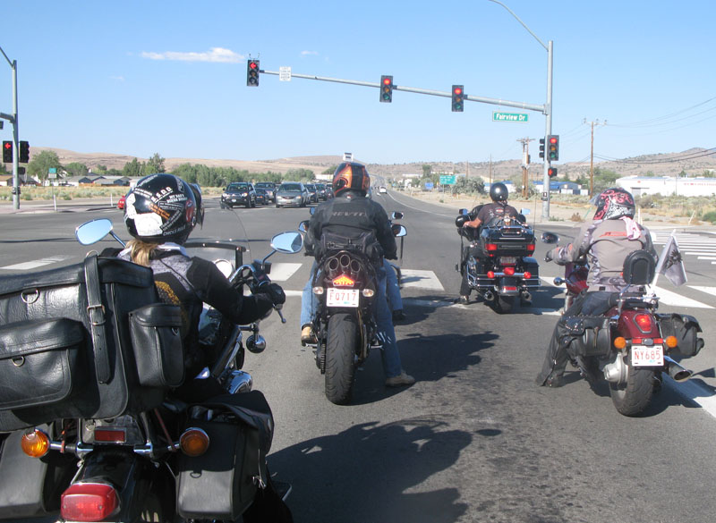 riding right riding in a group stopped at light