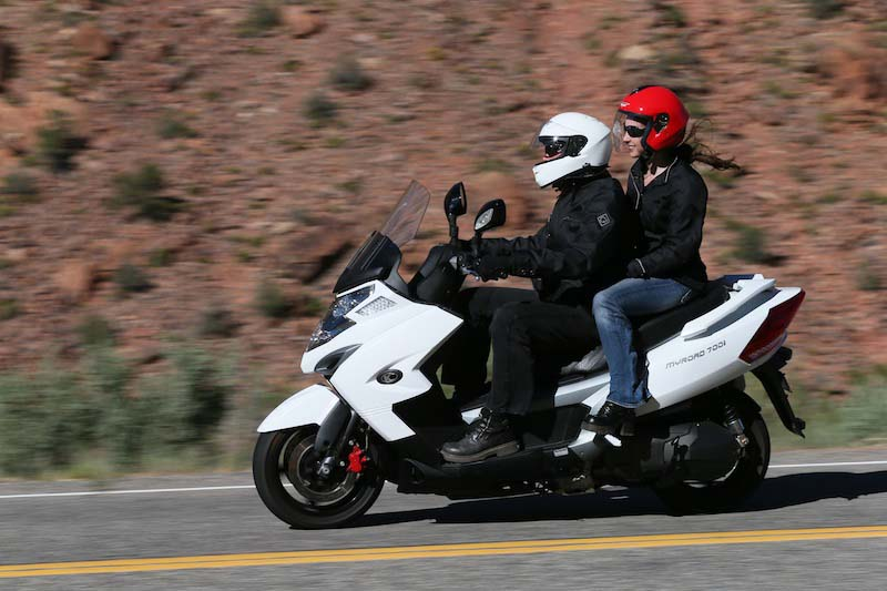 Scooter Review Kymco MyRoad 700i couple riding