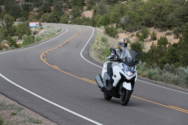 Scooter Review Kymco MyRoad 700i rider on curvy road
