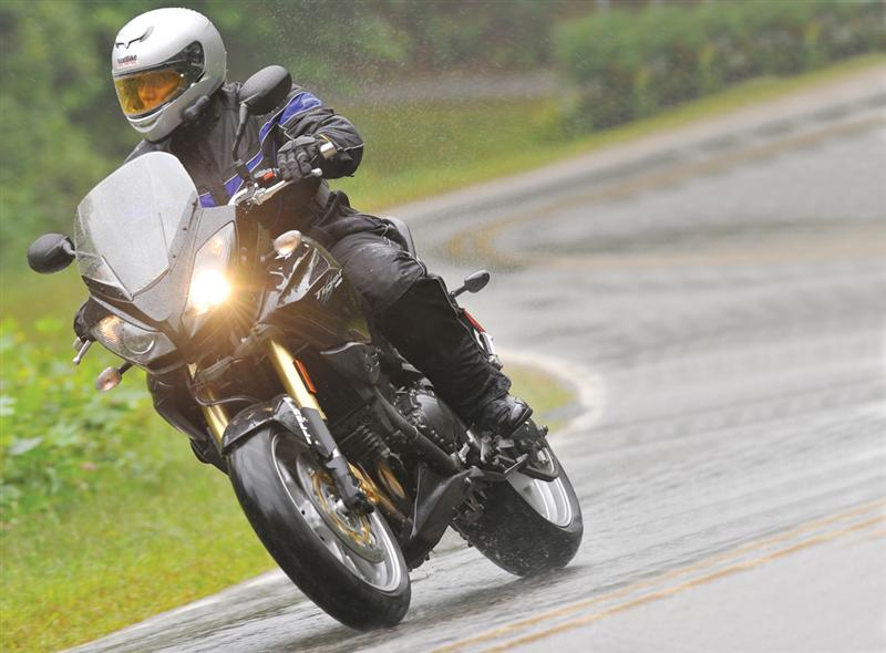 Riding a motorcycle in the rain is sometimes unavoidable. Always slow down your speed and follow the rules about limiting lean angles and using more gradual braking techniques.