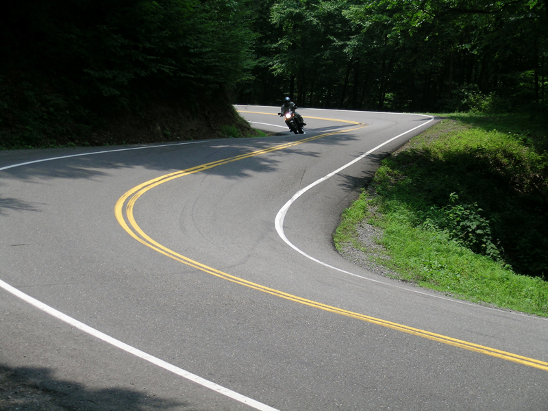 Motorcycle Riding on the Tail of the Dragon banked curve