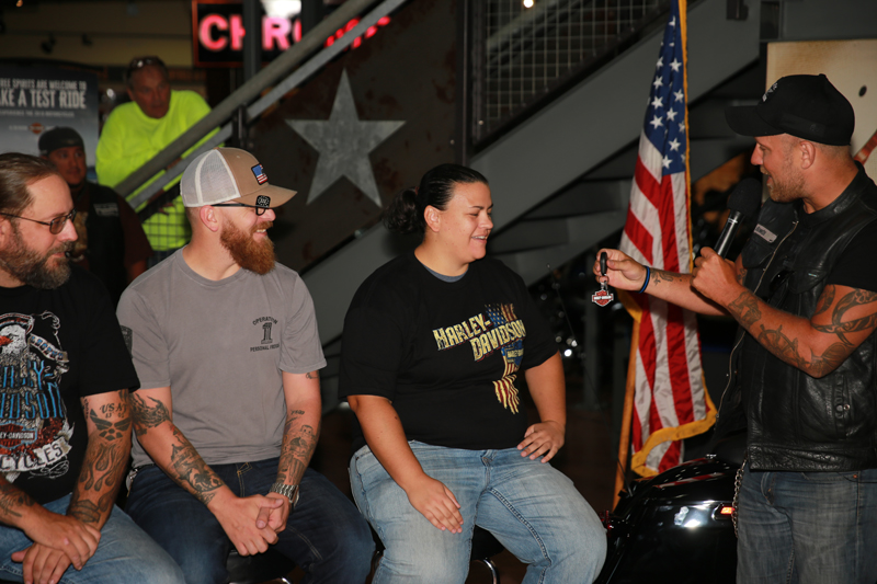 female retired air force medic receives new motorcycle as gift