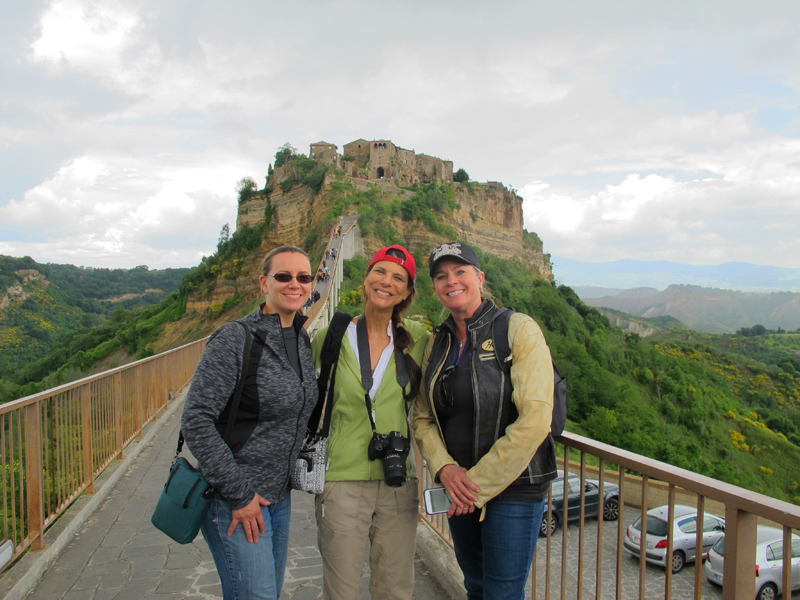 why you should ride a motorcycle in italy once in your life civita bagnaregio women
