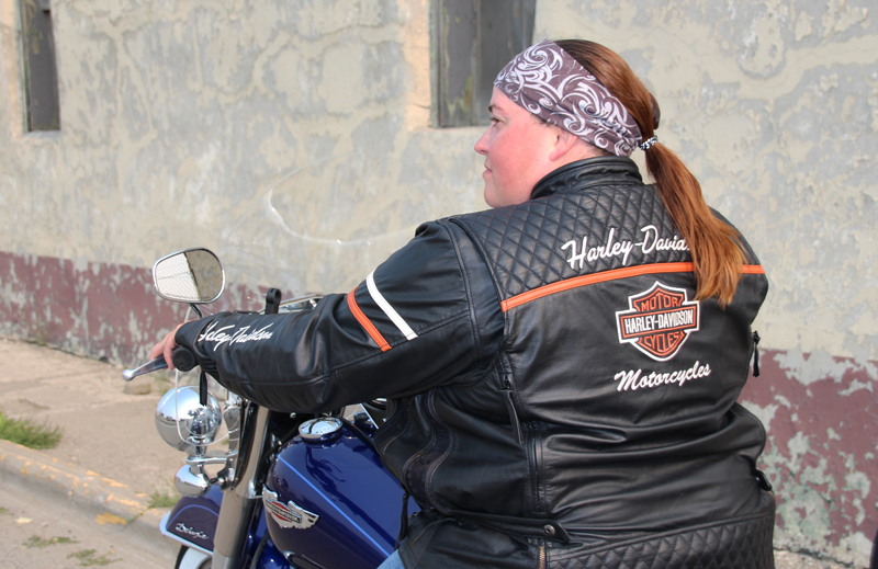 review miss enthusiast mid weight black leather motorcycle jacket on bike