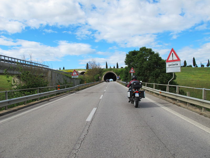 why you should ride a motorcycle in italy once in your life road sign