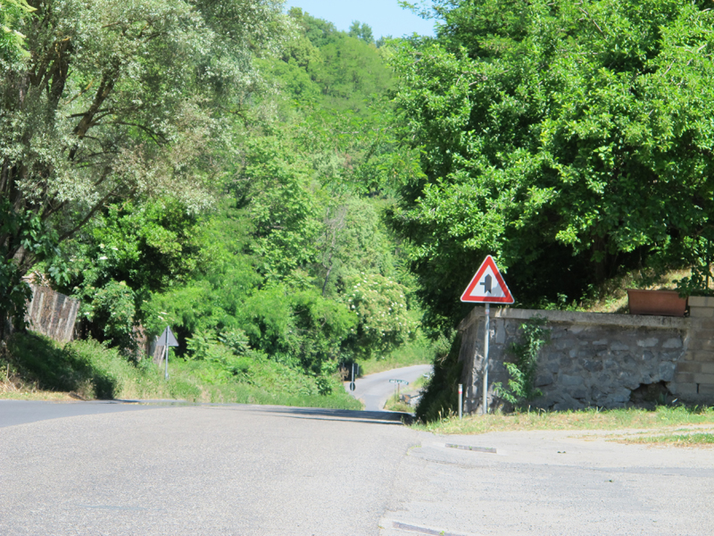 why you should ride a motorcycle in italy once in your life left turn sign