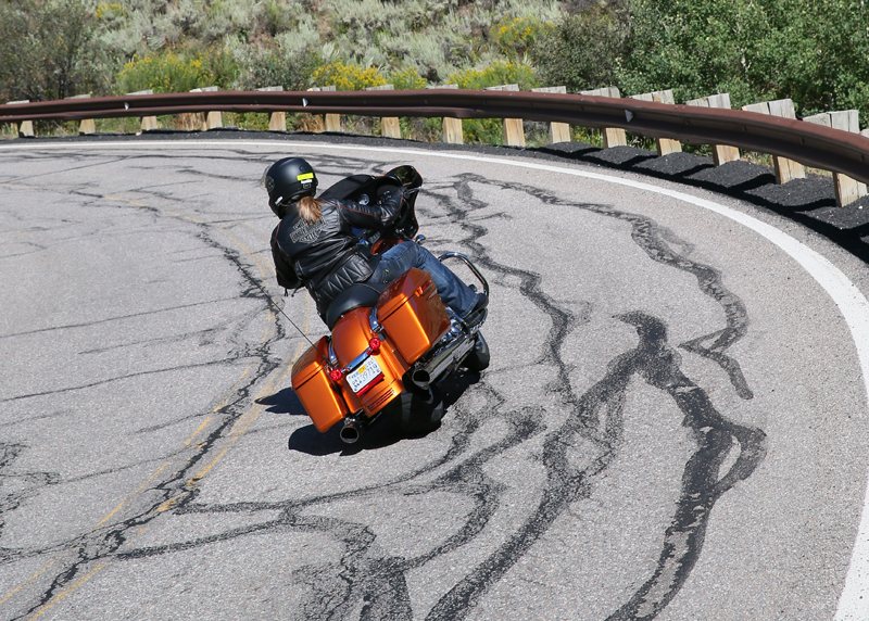 Black tar strips look innocent enough, but if you've ever passed over them on your motorcycle while leaning or making a turn you know they are slippery and cause the motorcycle to wiggle because of reduced traction.