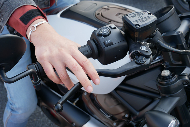 woman reaching for the brake lever on Harley-Davidson Sportster S